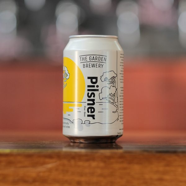 The Garden brewery India Pale Ale craft beer can with yellow sunset in Tisno artwork on the label.