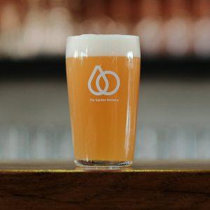 Branded brent 0,5l glass full of light juicy beer.