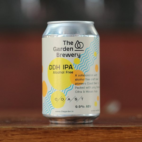The Garden Brewery can of non-alcoholic DDH IPA brewed in collab with Coast. Cream label with watercoloured yellow and orange dots and blue diagonal curved lines.