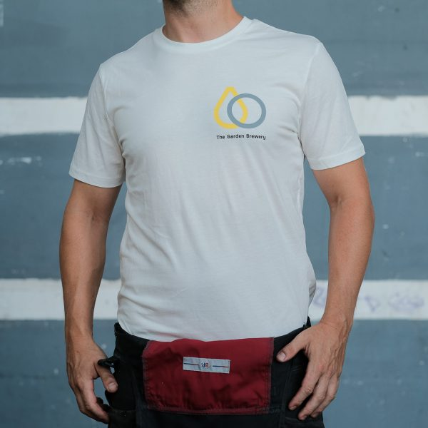 The Garden Brewery white T-shirt with yellow and grey icon on the left side of the chest.
